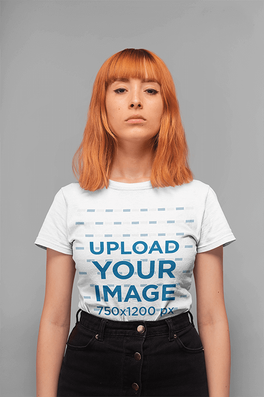 T Shirt Mockup Of A Serious Faced Girl Standing In A Studio