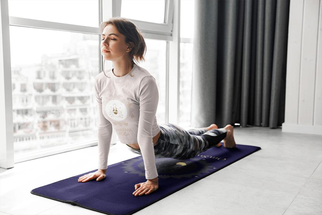 Long Sleeve Tee Mockup Of A Woman On A Customizable Yoga Mat