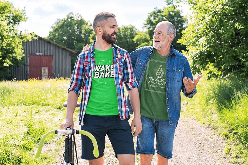 Mockup Of A Son And Father Wearing Matching T Shirts On A Sunny Day