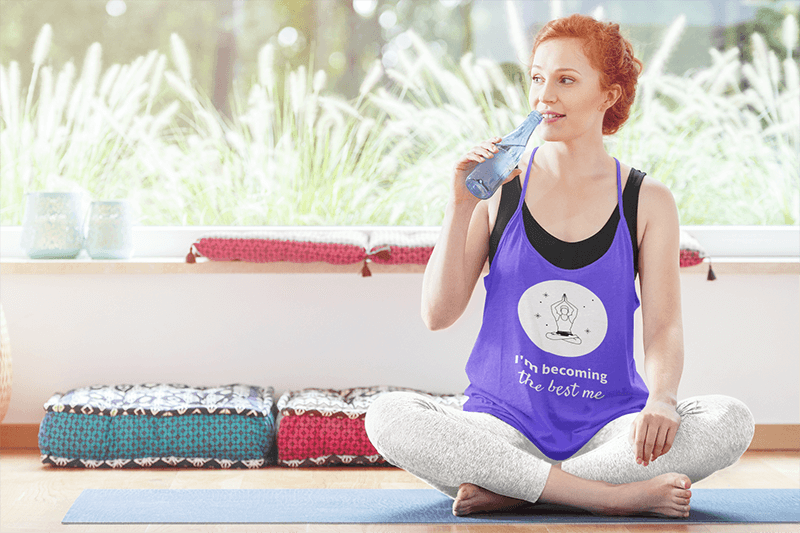 Mockup Of A Woman With A Loose Tank Top Drinking Water At A Yoga Class