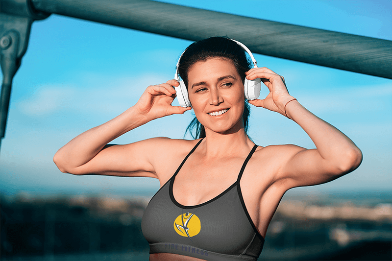 Sports Bra Mockup Of A Woman Putting On Headphones To Go For A Run