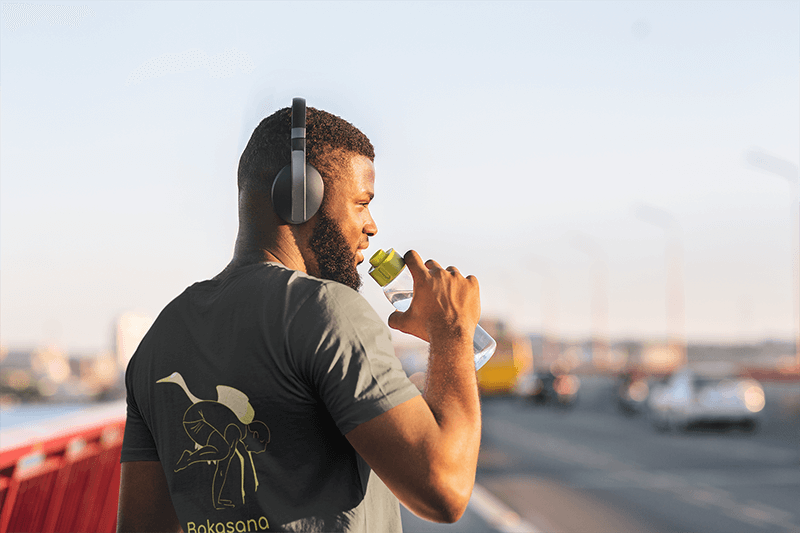 T Shirt Mockup Of The Back View Of A Runner Drinking Some Water