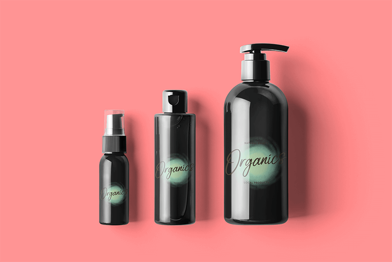 Minimal Mockup Featuring Three Cosmetic Bottles Placed Against A Solid Color Background