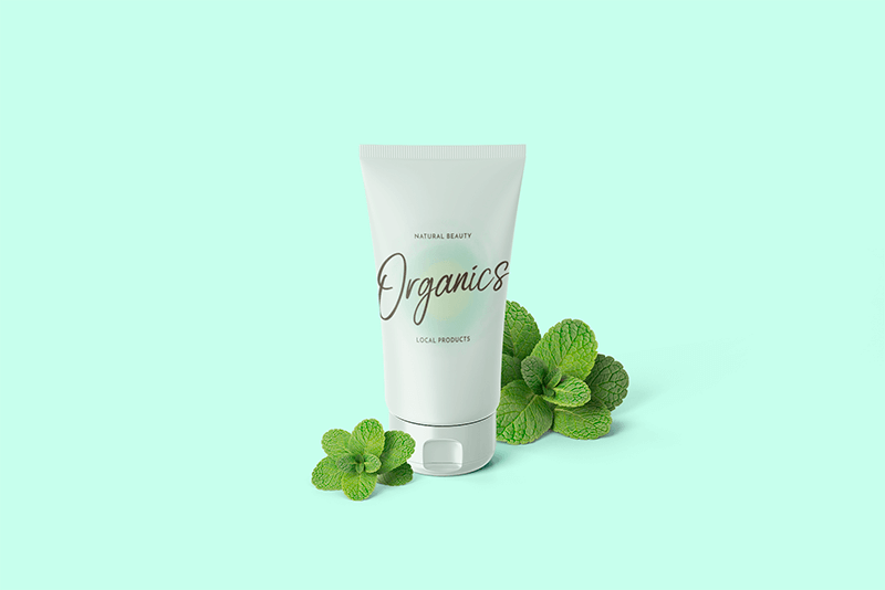 Mockup Of A Cosmetic Tube Surrounded By Fresh Mint Leaves