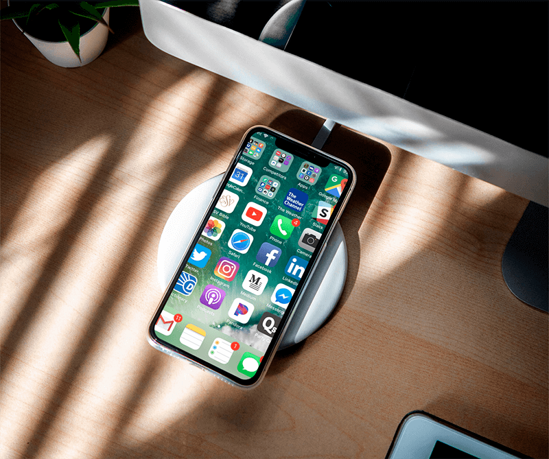 Mockup Of An Iphone 11 Pro Featuring A Wireless Charger