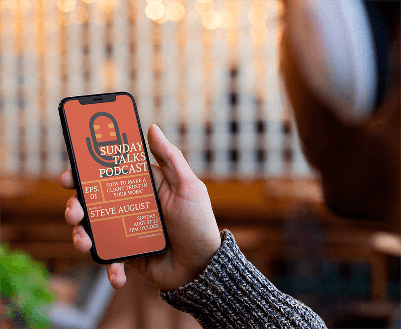 Mockup Of An Iphone X Held By A Man Listening To A Podcast