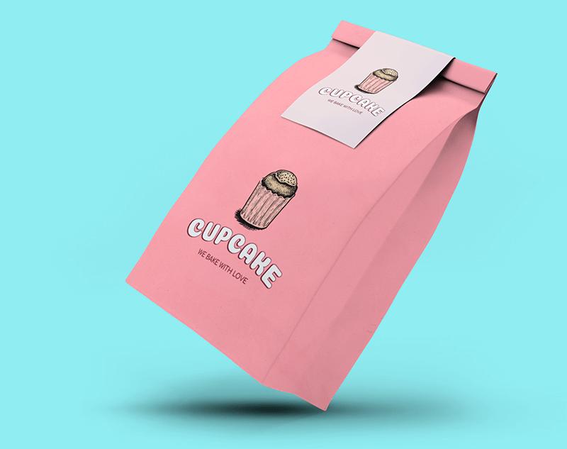 Packaging Mockup Of A Paper Bag Floating Against A Plain Color Backdrop