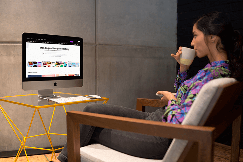 Woman Sipping Tea In Front Of An Imac Mockup