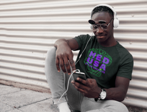 T Shirt Mockup Of A Man Listening Music On The Street