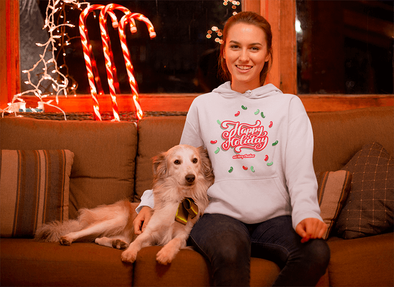 Christmas Hoodie Mockup Of A Woman Surrounded By Xmas Ornaments With Her Dog