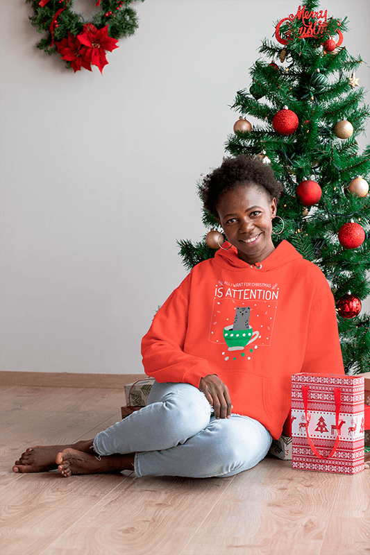 Mockup Of A Woman With A Hoodie Sitting Next To A Christmas Tree