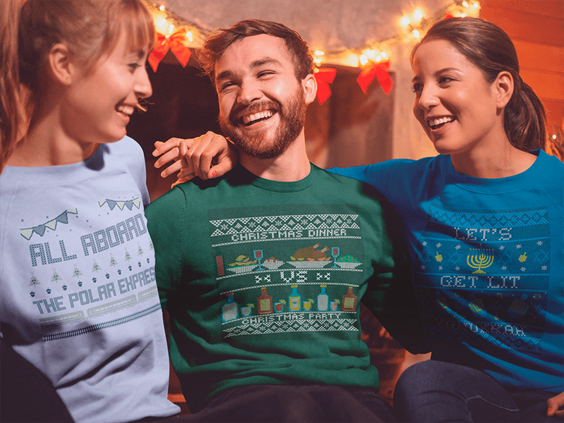 Sweatshirt Mockup Of Three Friends Celebrating Christmas