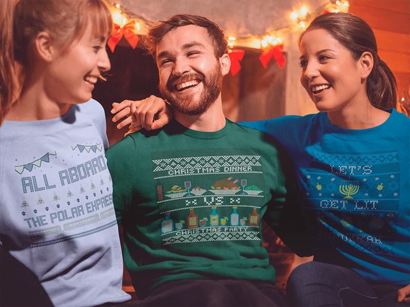 Sweatshirt Mockup Of Three Friends Celebrating Christmas