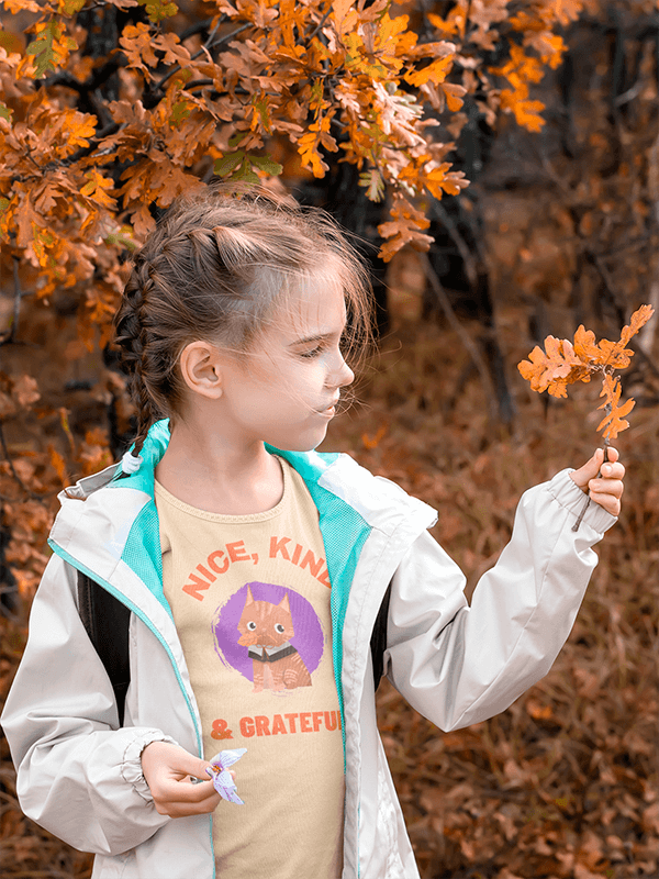T Shirt Mockup Featuring A Girl Holding Autumn Leaves