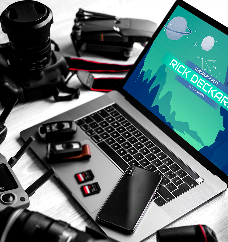 Mockup Featuring A Macbook Pro Surrounded By Photography Equipment