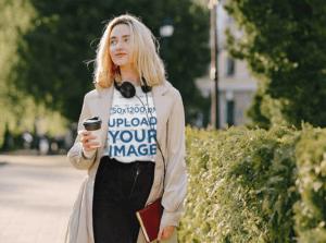 Copia De Tee Mockup Of A Trendy Woman Walking On Street.