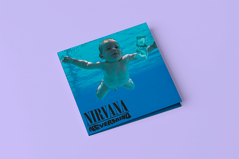 Digipak Mockup Featuring A Plain Color Background