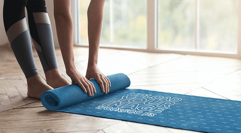 Mockup Of A Woman Rolling Up A Yoga Mat