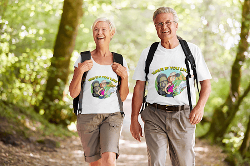 T Shirt Mockup Featuring A Senior Couple Hiking