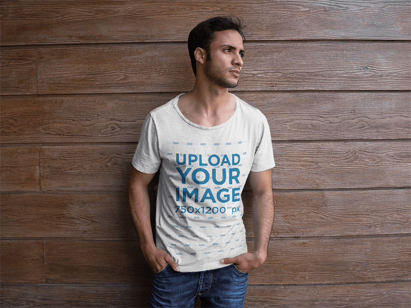 T Shirt Mockup Of A Man Leaning Against A Wood Wall