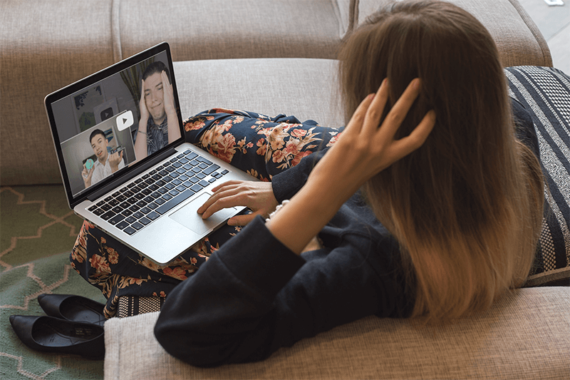 Woman Watching A Popular Youtuber