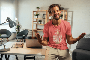 Round Neck Tee Mockup Of A Smiling Man In His Home Office