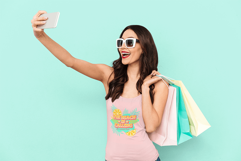 Tank Top Mockup Of A Woman Taking A Selfie While Shopping