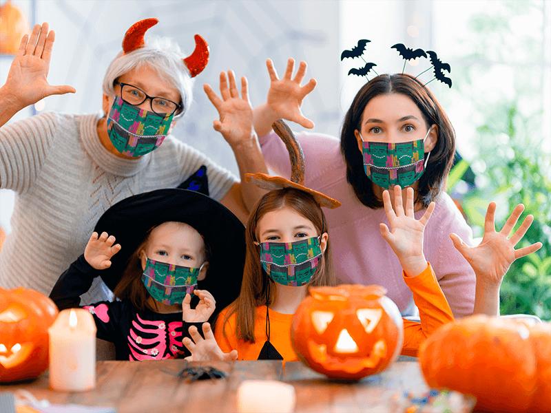 Face Mask Mockup Of A Family Celebrating Halloween