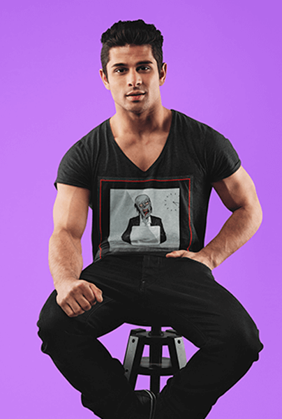 T Shirt Mockup Featuring A Young Man Sitting On A Stool At A Studio