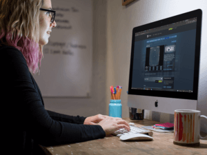 Girl Working In An Imac While Wearing Glasses At The Office