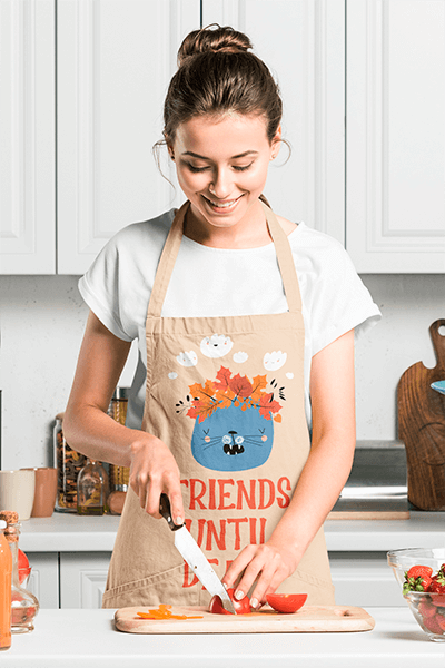 Mockup Of A Happy Woman Cooking At Home While Wearing An Apron