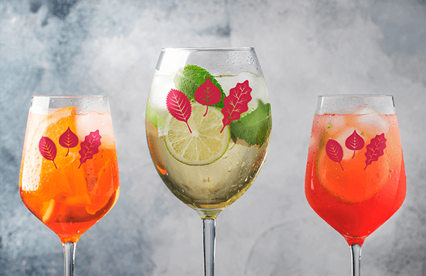 Mockup Of Three Wine Glassed Filled With Refreshing Cocktails
