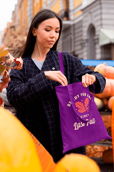 Tote Bag Mockup Of A Woman Buying Pumpkins On The Street