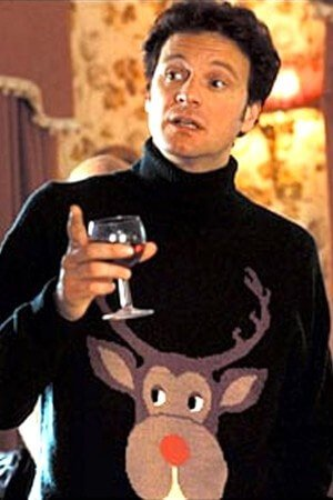 Mark Darcy from Bridget Jones Diary wearing the ugliest christmas sweater