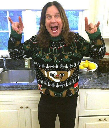 Ozzy Osbourne wearing an atrocious christmas sweater